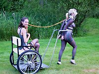 Charlotte Brooke runs strapped ponygirls